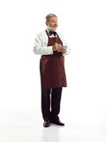 Senior waiter and standing isolated on white studio background. concept of good service - 233009820