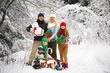 Happy family with christmas gifts in winter forest