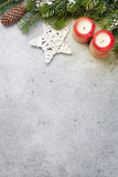 Christmas decor, candles and fir tree branch © karandaev