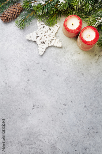 Christmas decor, candles and fir tree branch - 233022445