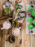Christmas Muffins with green cream and hot chocolate with marshmallows. Top view - 233032670