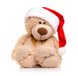 Christmas toy bear with santa hat on a white background isolation