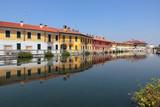 EDIFICI CON RIFLESSO SUL NAVIGLIO A GAGGIANO IN ITALIA, BUILDINGS WITH REFLECTION ON NAVIGLIO IN GAGGIANO IN ITALY - 233035654