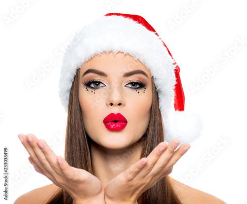 Myśląca kobieta w Santa kapeluszu.