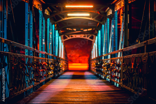 Fridge magnet Front view of a bridge at night with padlocks on sides as symbol of love and friendship