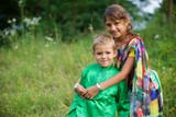 A lot of small children, boys and girls, dressed in the clothing culture of India. - 233048663