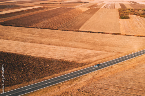Poster Aerial view of cars driving on the road