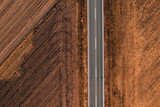 Aerial view of empty road through countryside - 233051434