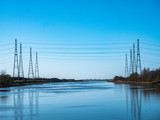 Electricity Pylons carry cables over River Ribble - 233052400