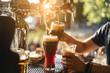Leinwandbild Motiv bartender pours a dark beer close up