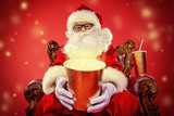 santa claus with popcorn and drink - 233061203