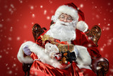 santa claus in armchair  with gifts - 233061453