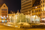 Wroclaw old city with fountain at night, Poland
