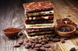 Leinwanddruck Bild - Chocolate bars on table with chocolate tower.