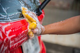 Cleaning red car, Automobile washing concept - 233085265
