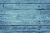 Old blue shabby wooden planks with cracked color paint - 233108420