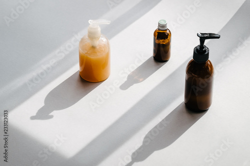 Clear plastic and glass brown bottles with organic cosmetics from