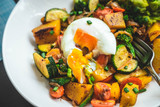 Roasted veggies salad, pumpkin, zucchini, broccoli with avocado and poached egg. Healthy eating, food photography concept. Top view - 233123283