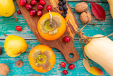 Autumn harvest, fruits and autumn vegetables on a wooden background.