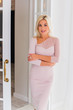 Leinwandbild Motiv Woman in beige elegant dress , fashionable classical dress, modern women and fashion concept