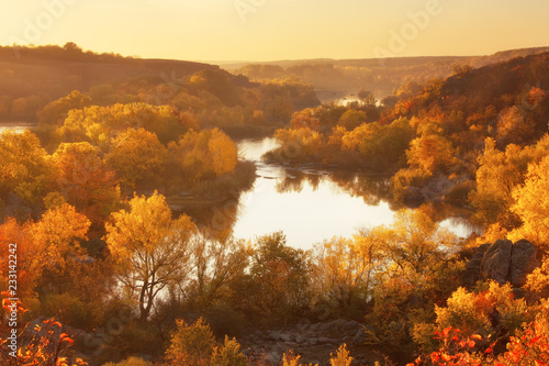 Foto Murales Autumn sunrise on the banks of the river, beautiful fall season landscape