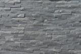 Decorative wall spliced with stone strips - 233145830