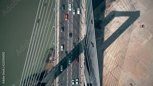 mata magnetyczna Aerial top-down view of cars moving along cable-stayed bridge