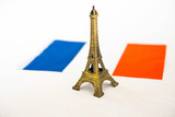Metal Eiffel Tower and French flag on background - 233157696