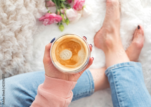 Woman's hand holding a glass cup with coffee - 233161257
