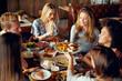 Friends having dinner at restaurant. Multi ethnic group. - 233182646