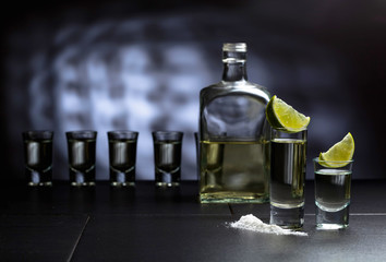 Tequila and lime slices.