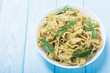 Leinwandbild Motiv Pasta tagliatelle with green sauce pesto . Italian food background