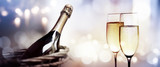 Cheers with a bottle of champagne for a new year - 233195864