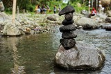 Stone balancing on the edge of the river