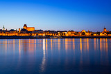 Old town of Torun at night reflected in Vistula river, Poland - 233212059