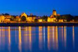 Old town of Torun at night reflected in Vistula river, Poland - 233212099