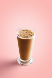 Large cappuccino coffee in transparent mug on a colorful red background - 233217434