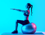 one mixed races woman exercsing fitness pilates exercices isolated on blue blackground - 233219848