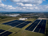 Aerial View of a Field of Solar Panels - 233221050