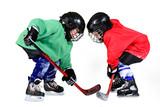 Boy playing ice hockey. Little hockey player isolated on white background. - 233237627
