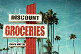 aged and worn discount groceries sign - 233243268