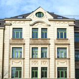 renovated vintage house main facade with decorated windows pattern, Gera city in Thuringen, Germany - 233244098