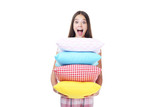 Young girl holding colorful pillows on white background - 233252850