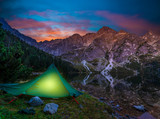 Tent over a mountain lake in the Tatras. Morskie Oko, Poland - 233253684