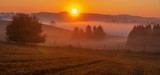 beautiful, misty sunrise over autumnal meadows and fields - 233253861