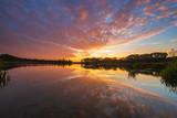 fiery sky ,beautiful sunset over an autumn lake - 233254087