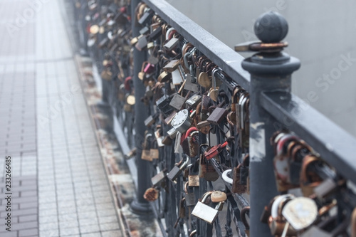 Foto Murales various locks on the railing of the park, a symbol of love