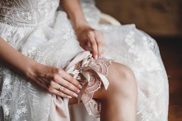The bride wears a garter on her wedding day.
