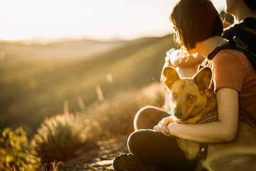girl with dog at sunset