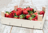 Strawberries surrounded by rustic background - 233326079